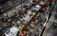Robotic arms assemble automobile chassis on a production line inside the Mercedes-Benz AG automobile plant, operated by Daimler AG, in Kecskemet, Hungary, on Friday, April 29, 2016. Daimler's Mercedes factory will produce a new generation of compact vehicles, totalling Daimlers investment in Hungary to more than $1.8 billion. Photographer: Akos Stiller/Bloomberg