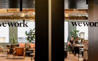 FILE PHOTO: WeWork logos are seen at a WeWork office in San Francisco, California, U.S. September 30, 2019.  REUTERS/Kate Munsch/File Photo - RC1F23BA0720